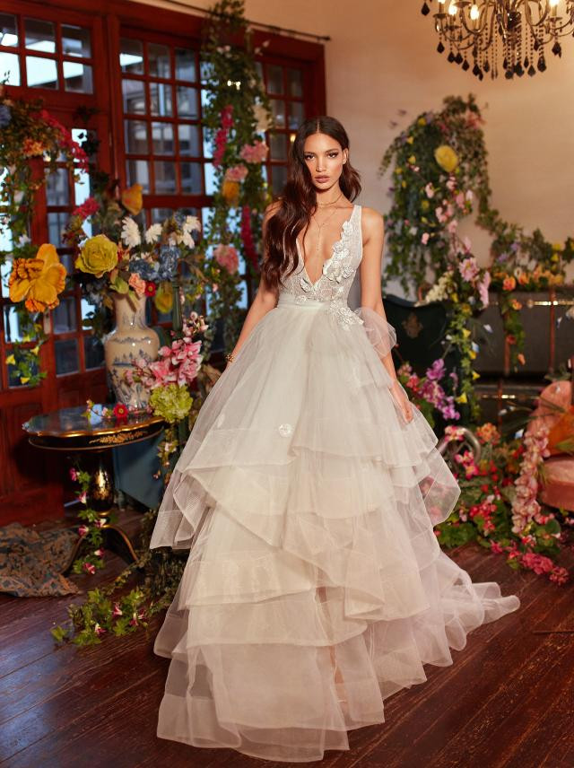 A Galia Lahav ball gown wedding dress with a layered tulle skirt and a deep v neckline