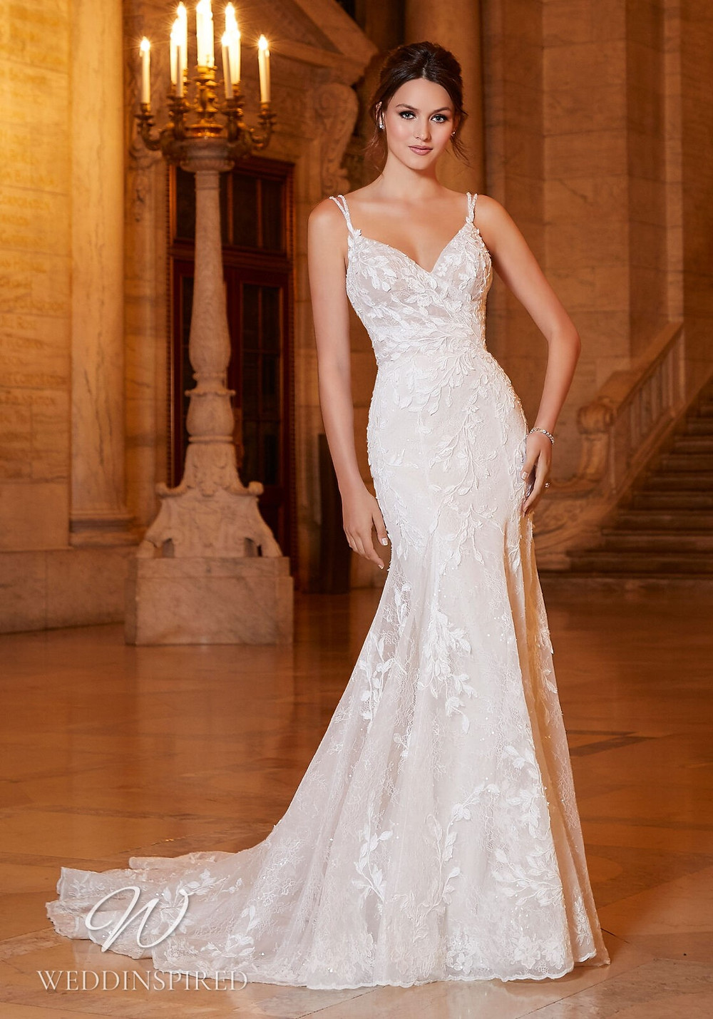 A Madeline Gardner lace mermaid wedding dress with a v neckline with straps