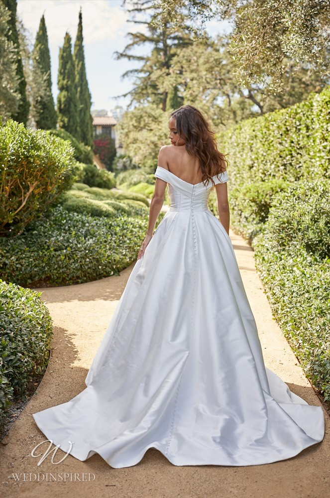 A Monique Lhuillier Bliss Spring 2021 off the shoulder satin A-line wedding dress with a slit