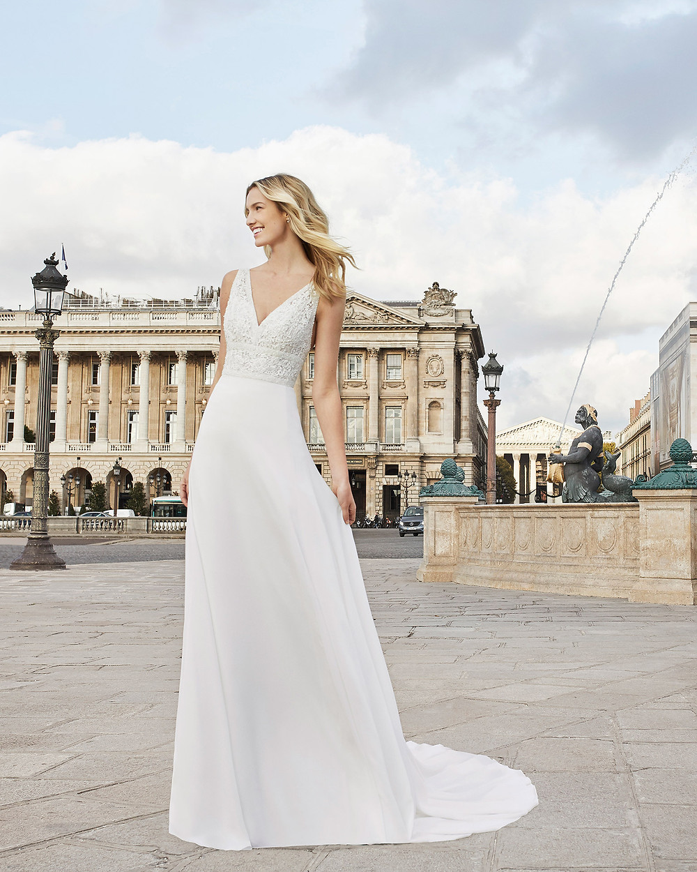 An Aire Barcelona 2020 crepe A-line wedding dress with a sparkly top and a v neckline