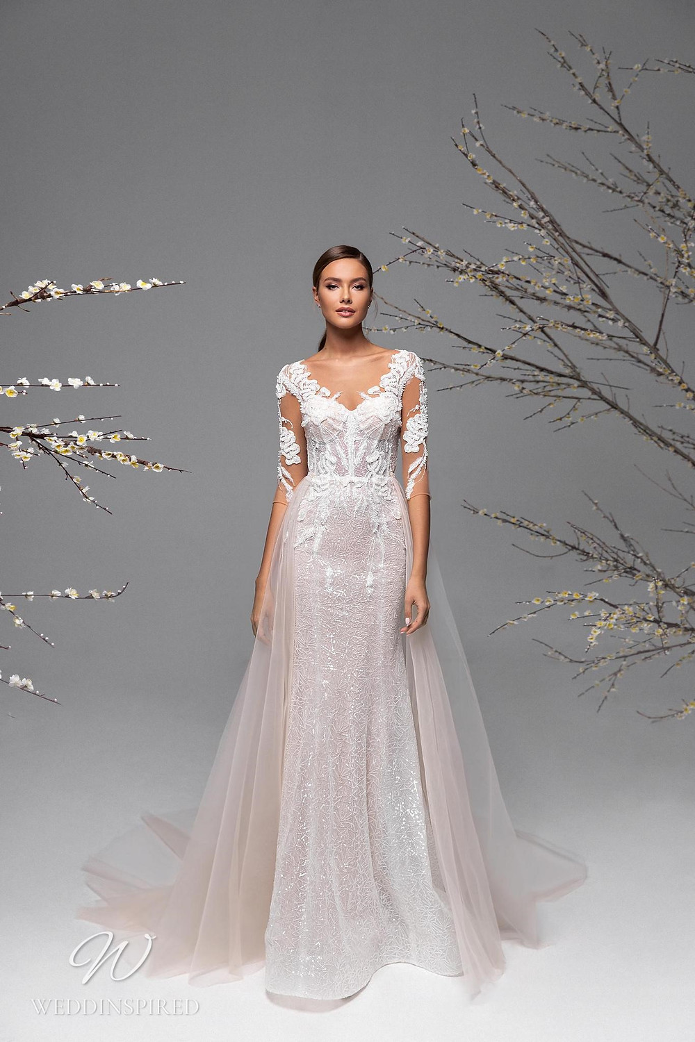 A Ricca Sposa blush lace and mesh column wedding dress with tulle detachable skirt