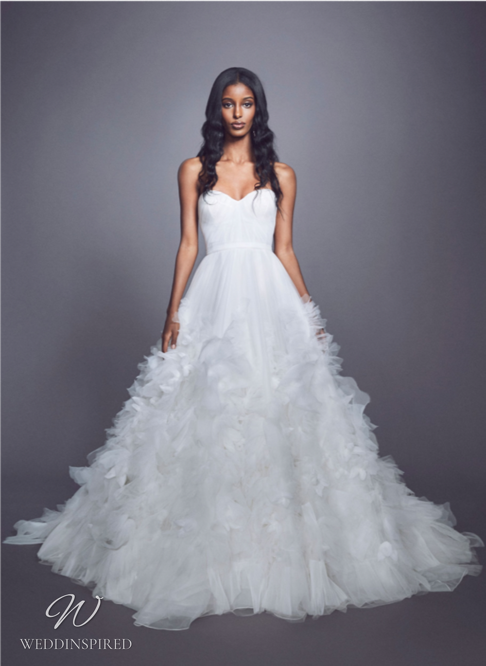 A Marchesa Fall 2021 strapless tulle ball gown wedding dress with a tulle ruffle skirt