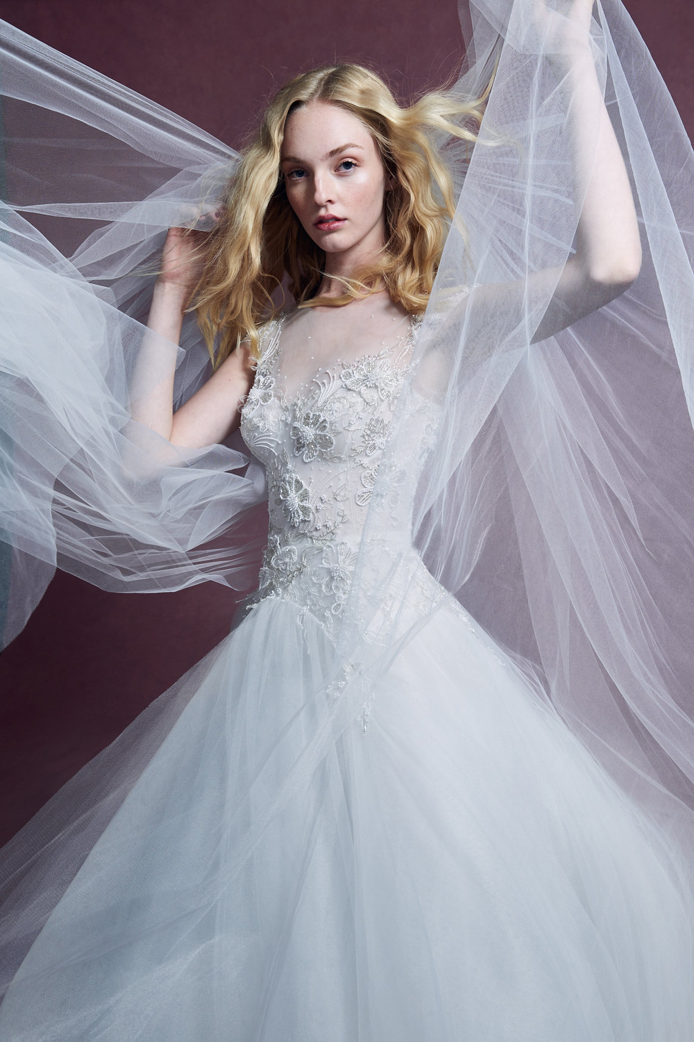 A Marchesa 2020 ball gown wedding dress, with a tulle skirt, delicate lace bodice and an illusion neckline with beading