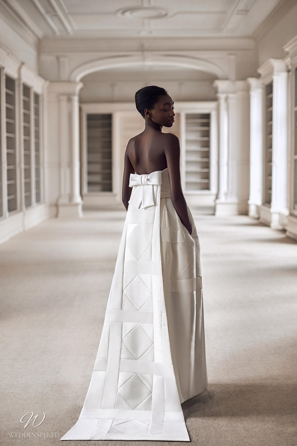 A Viktor & Rolf 2021 sheath wedding dress with a bow and geometric patterns
