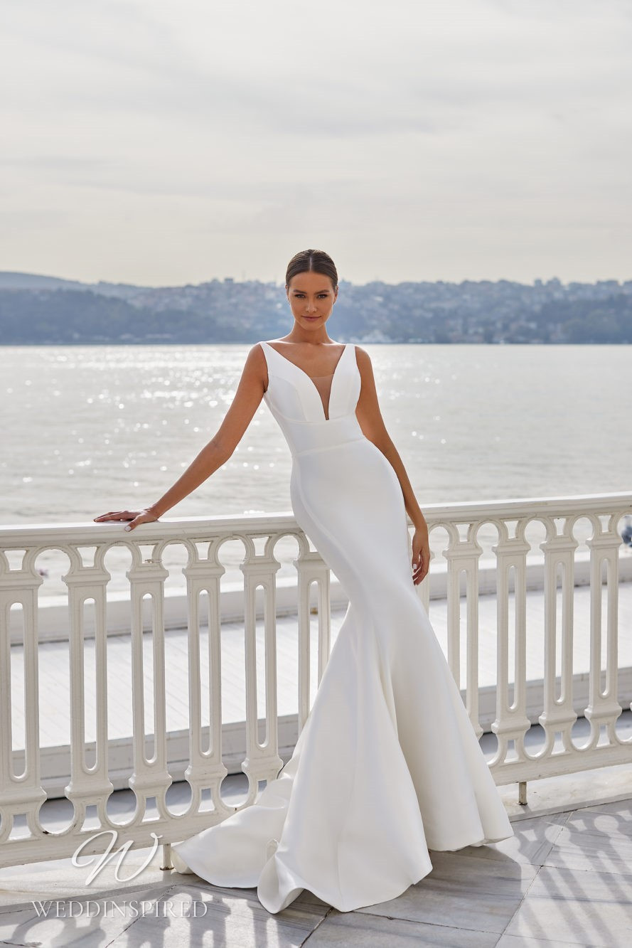 A Milla Nova 2021 simple satin mermaid wedding dress with straps and a v neck