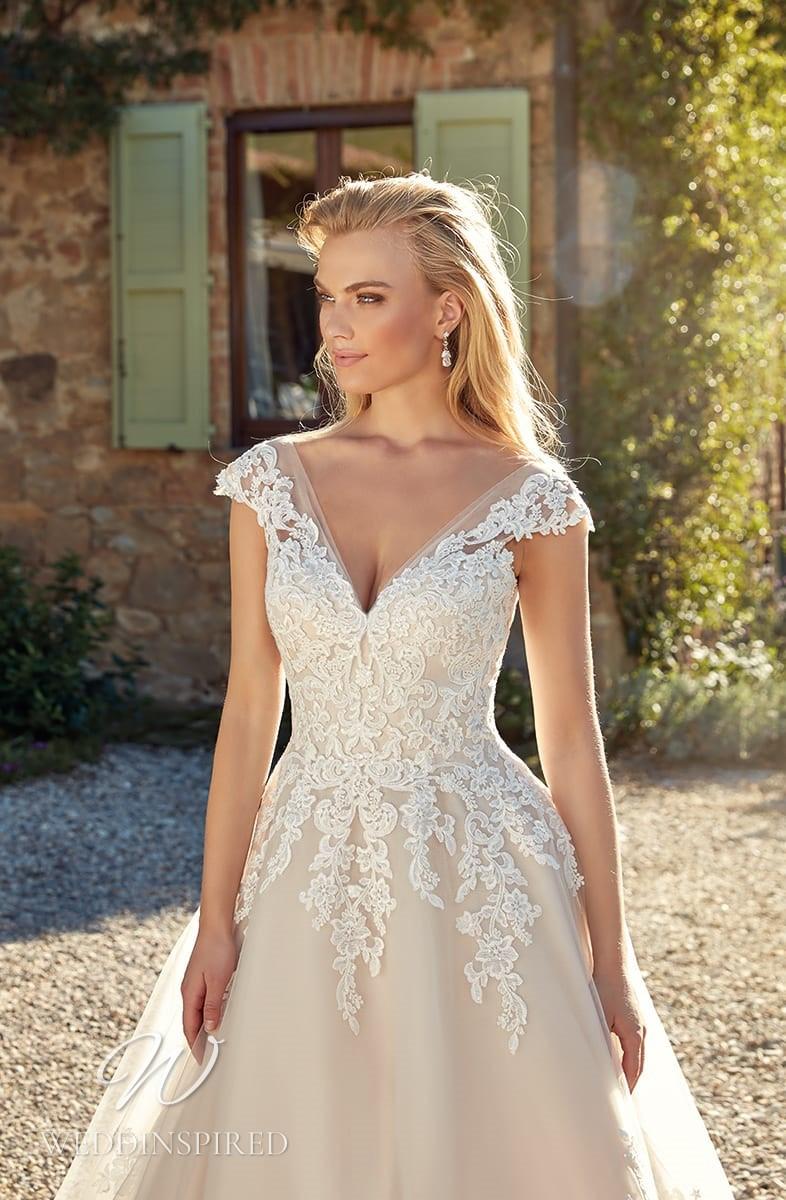 An Eddy K 2021 blush off the shoulder lace A-line wedding dress