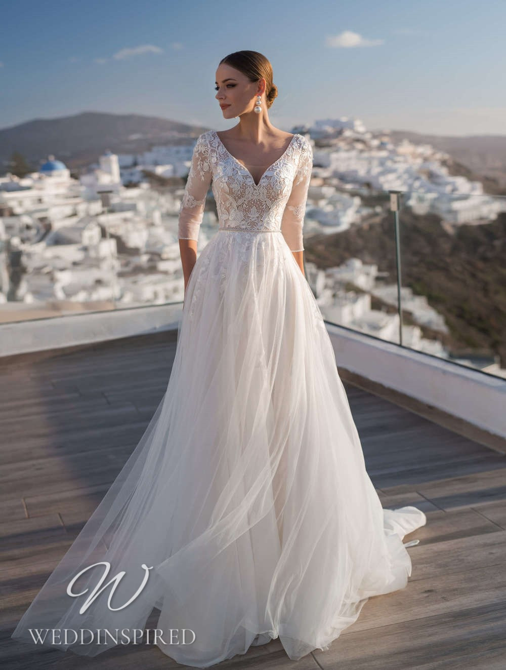 A Blunny 2021 flowy tulle A-line wedding dress with 3/4 sleeves
