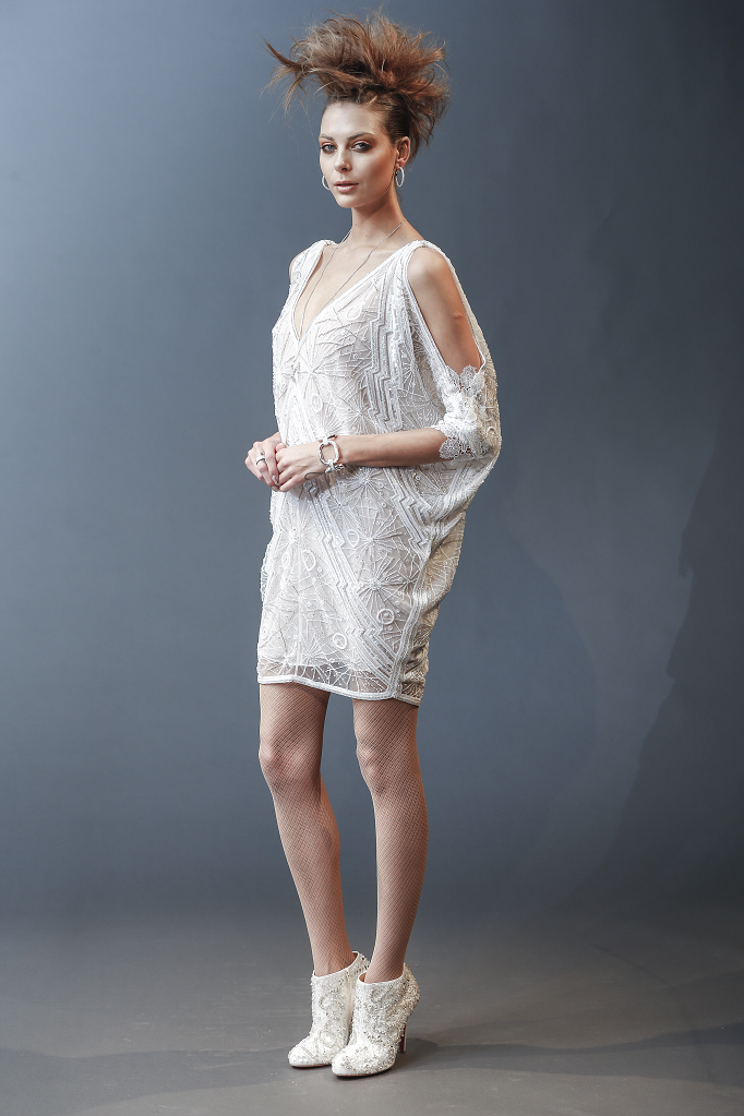 A Naeem Khan short slouchy wedding dress with long sleeves
