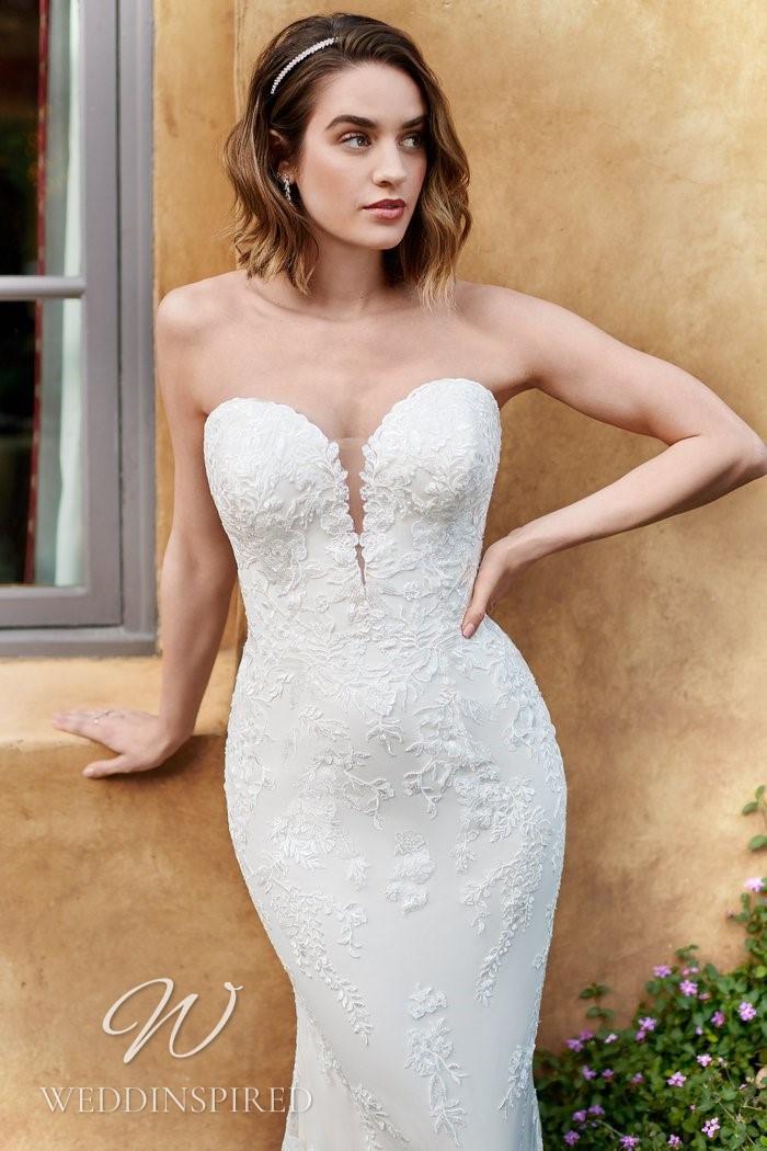 A Kenneth Winston 2021 strapless lace mermaid wedding dress