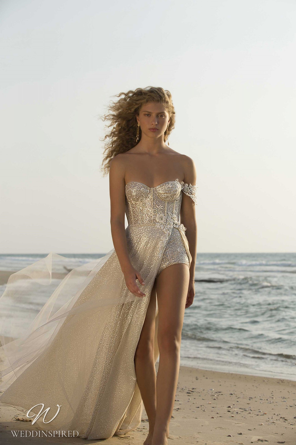 A Muse by Berta gold beach strapless A-line wedding dress with a slit and detachable skirt