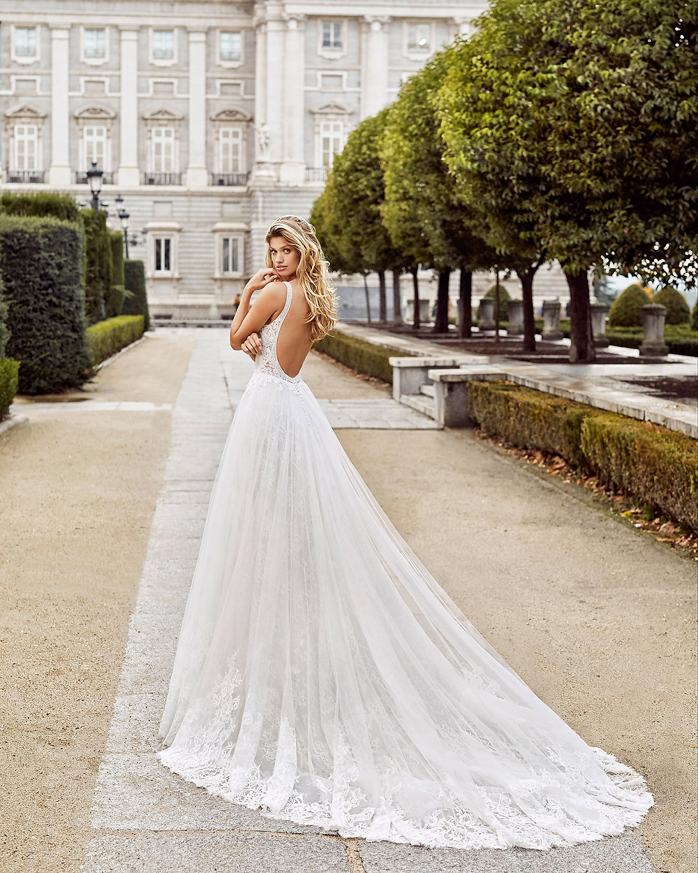 An Aire Barcelona 2020 lace A-line wedding dress with straps and a low back