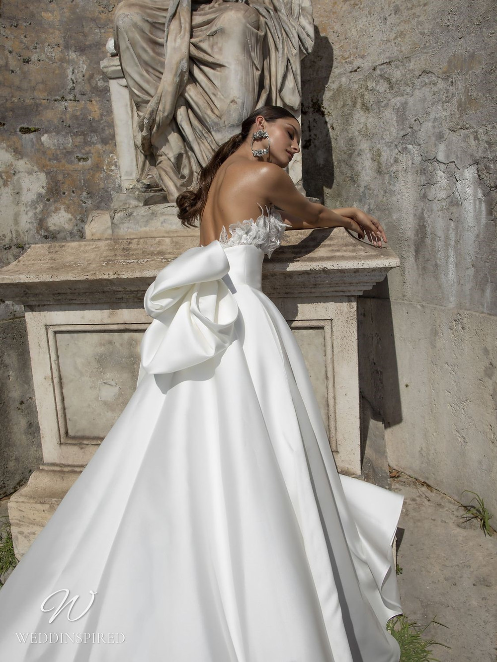 A Pinella Passaro strapless silk satin ball gown wedding dress with a big bow