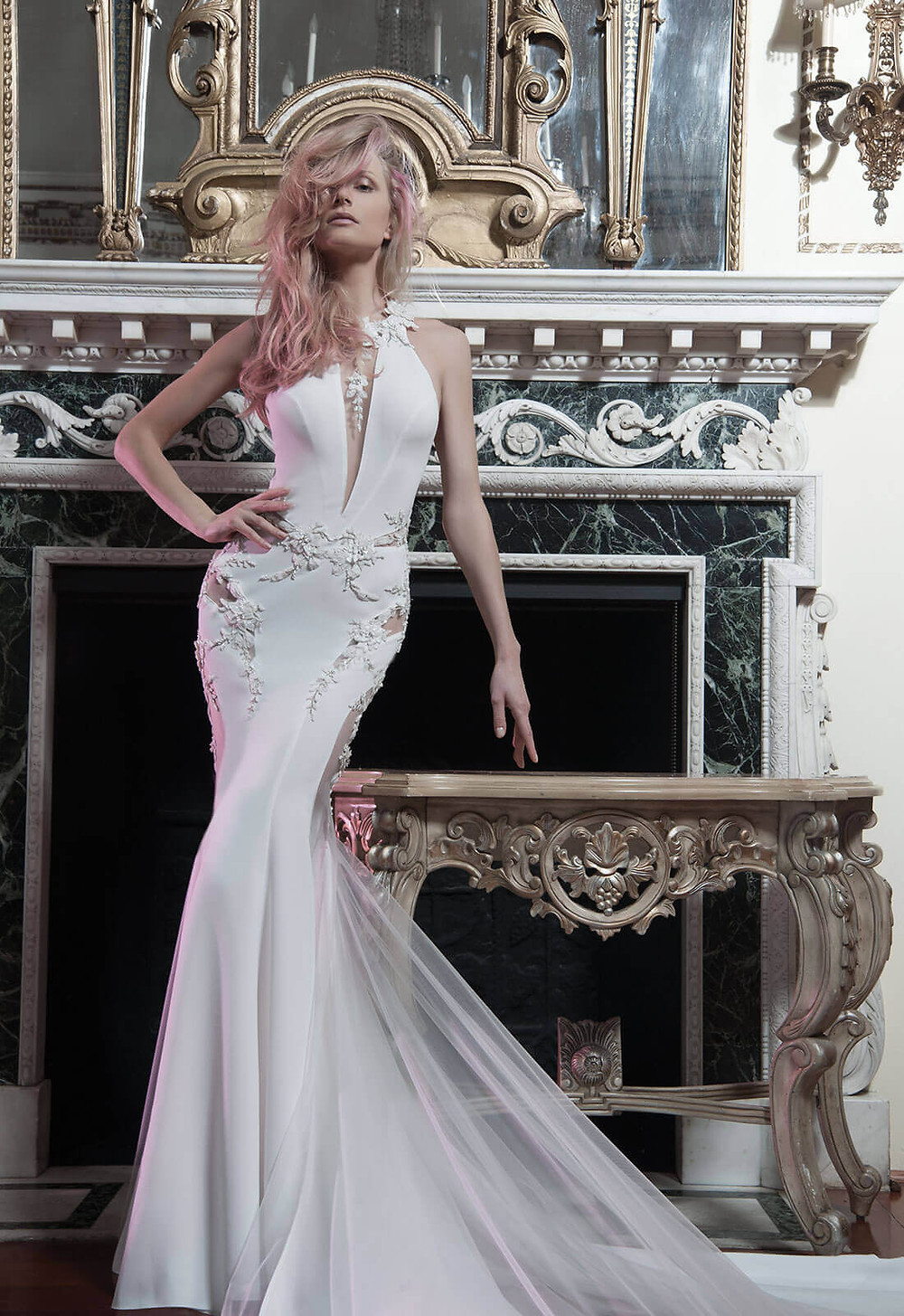 A Pnina Tornai halterneck lace and crepe mermaid wedding dress