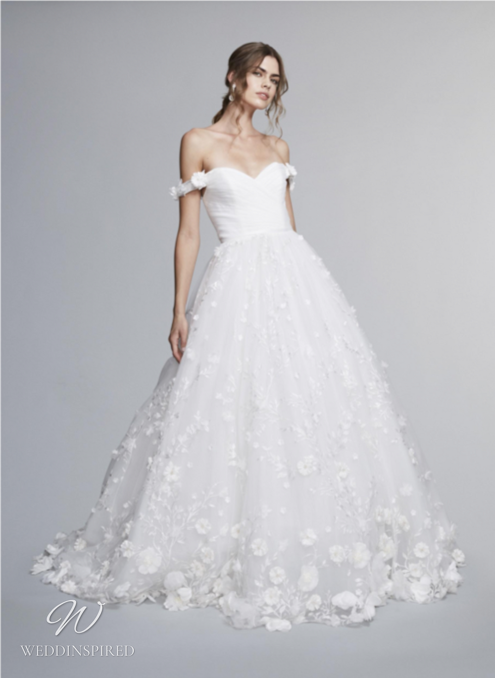 A Marchesa Notte Fall 2021 off the shoulder tulle A-line wedding dress with floral details