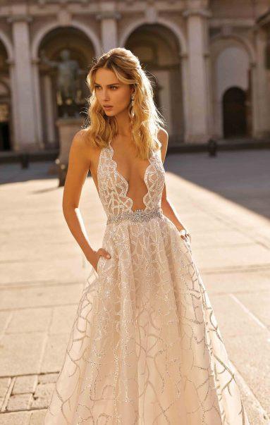 A Berta 2020 blush sparky mesh A-line wedding dress with a deep v neckline