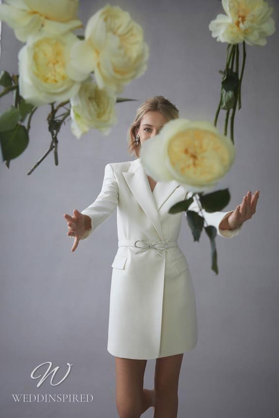 An Oscar de la Renta 2022 blazer style short wedding dress