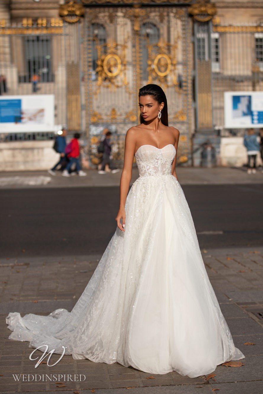 A Milla Nova strapless lace princess ball gown wedding dress
