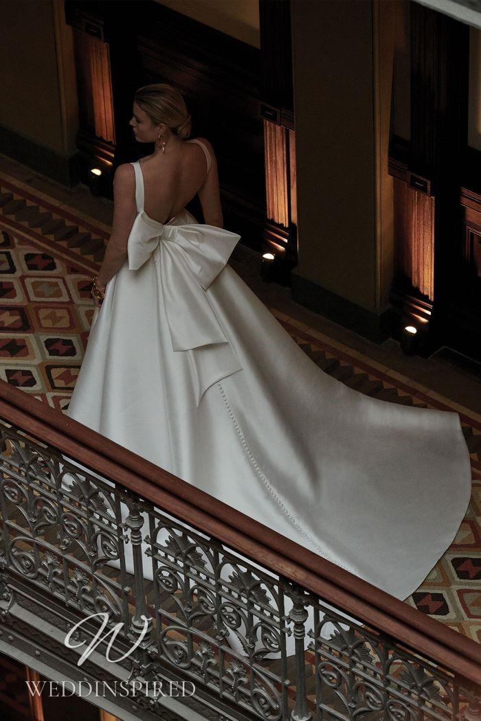 A Justin Alexander 2021 simple satin princess wedding dress with a bow