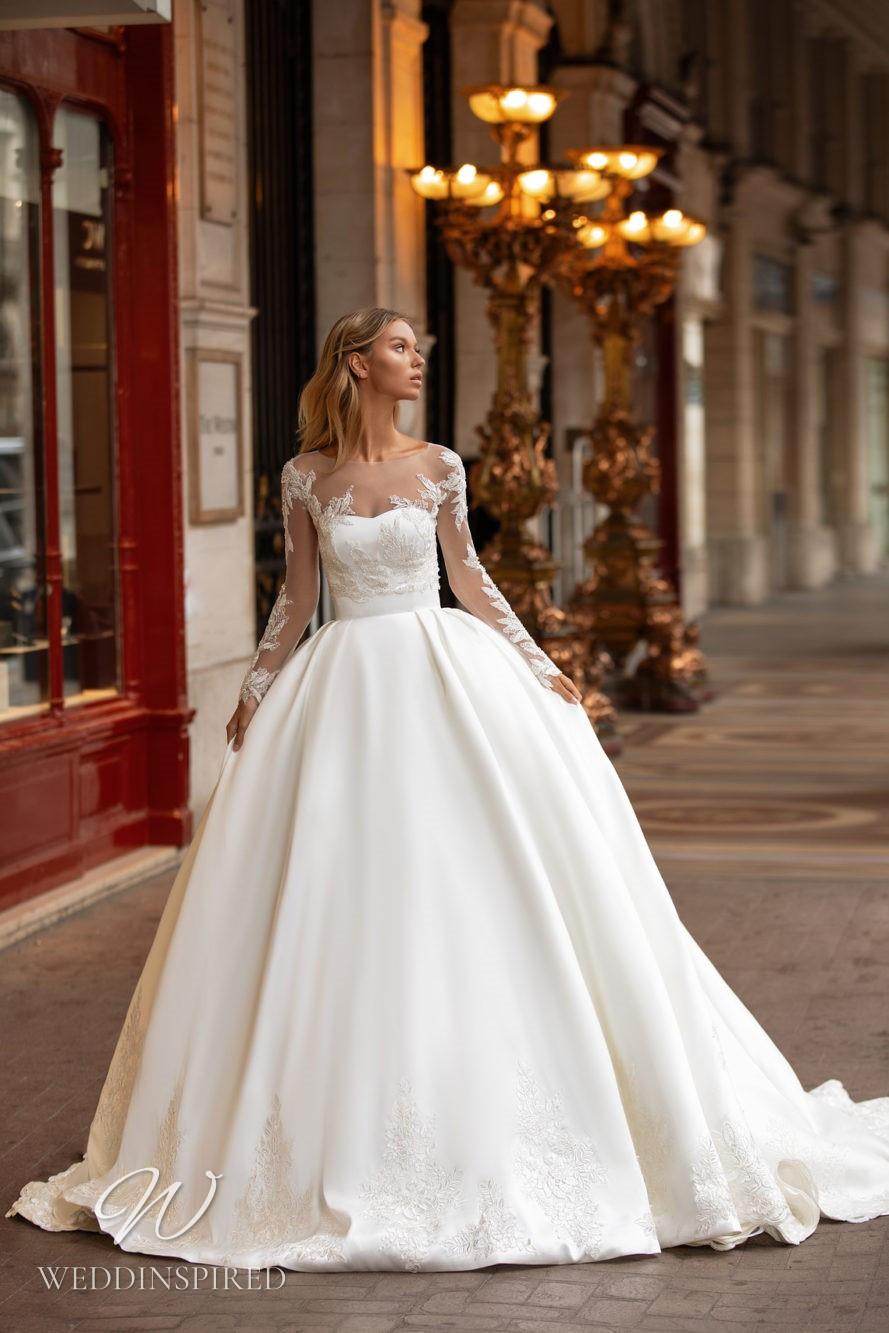 A Milla Nova princess ball gown wedding dress with an illusion top