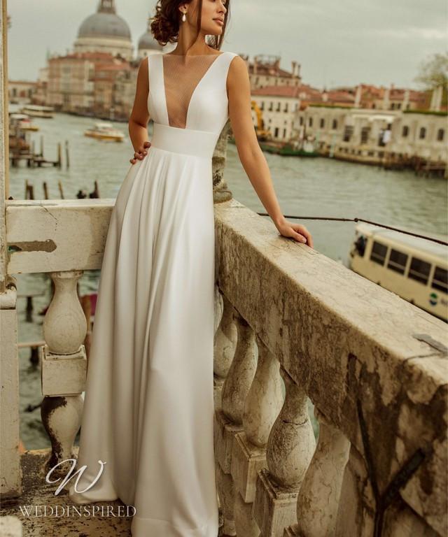 A Rara Avis 2021 crepe A-line wedding dress with a low v neckline