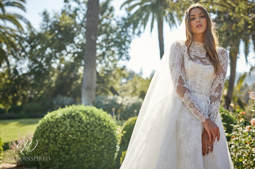 A Monique Lhuillier lace A-line wedding dress with long lace illusion sleeves