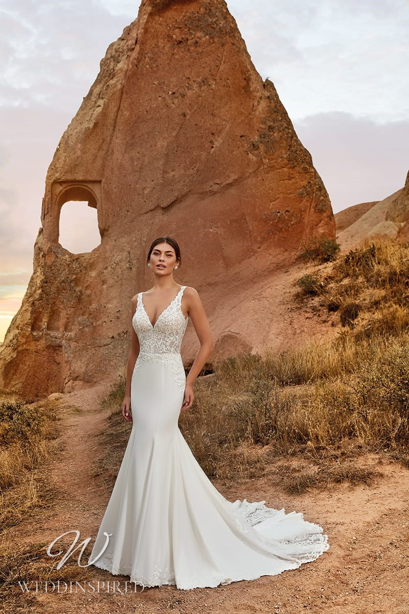 An Eddy K 2021 lace and crepe mermaid wedding dress with a v neck
