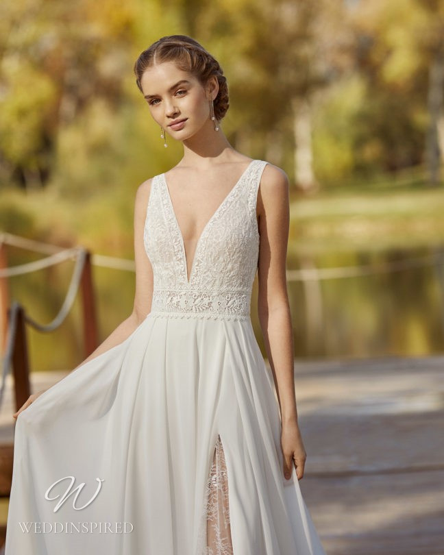 An Aire Barcelona 2021 lace and chiffon A-line wedding dress with a v neck