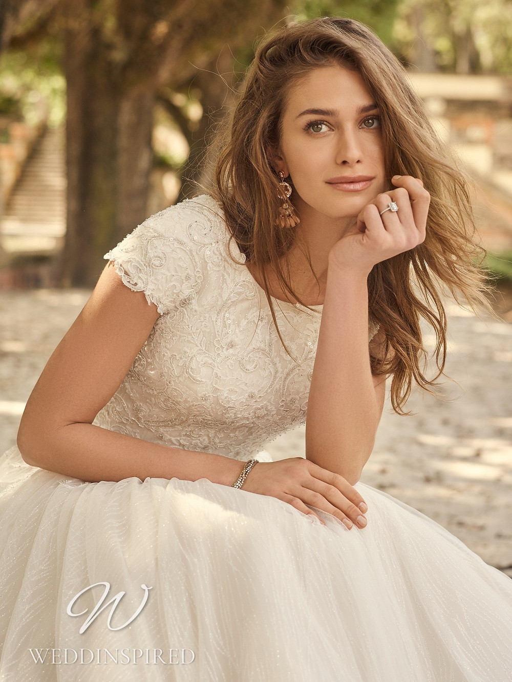 A Maggie Sottero 2021 lace A-line wedding dress with cap sleeves