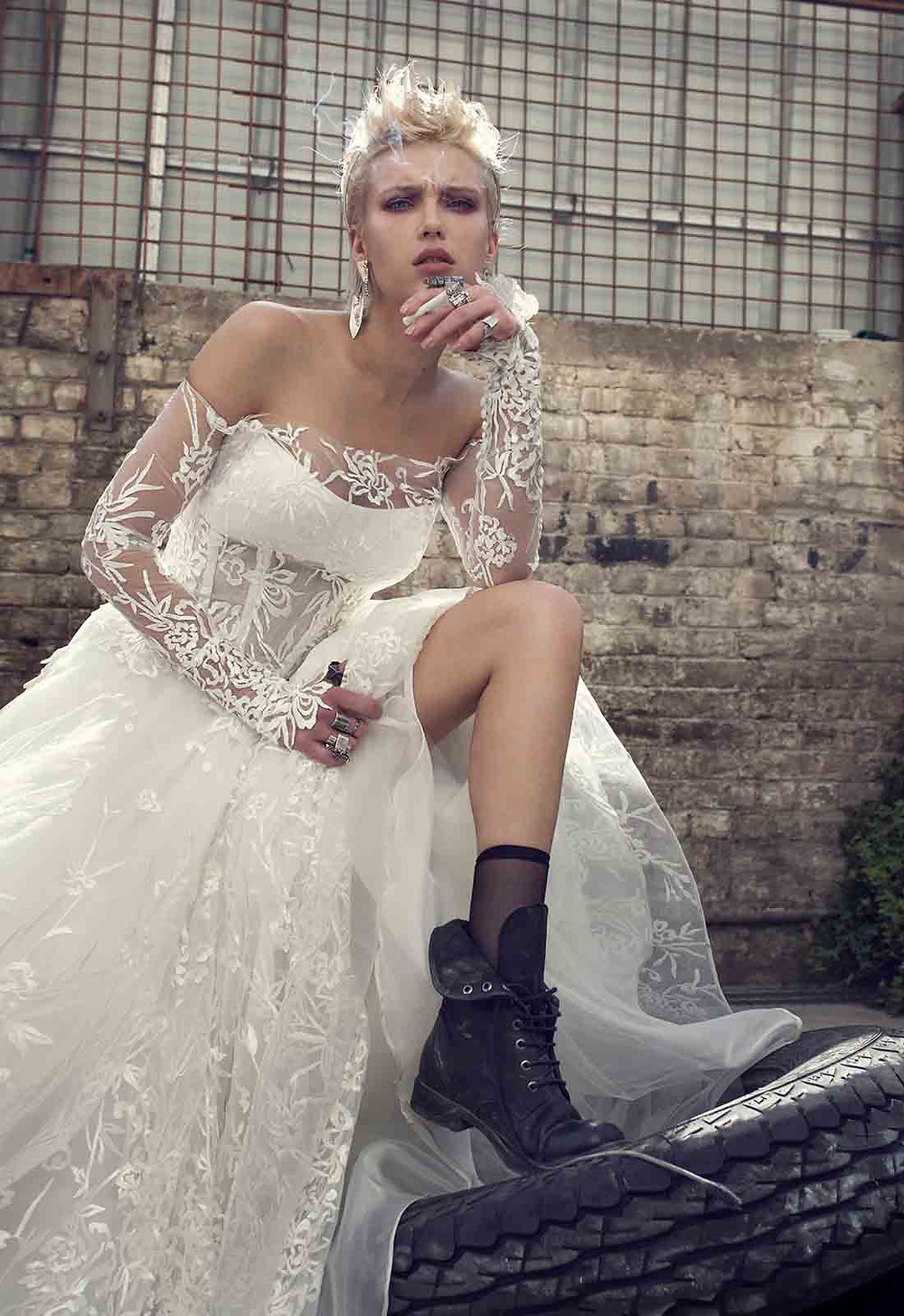 An off the shoulder A-line wedding dress with long illusion sleeves, tulle and lace