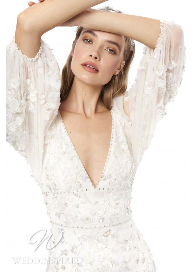 A Jenny Packham 2021 bohemian style sheath wedding dress with a v neckline