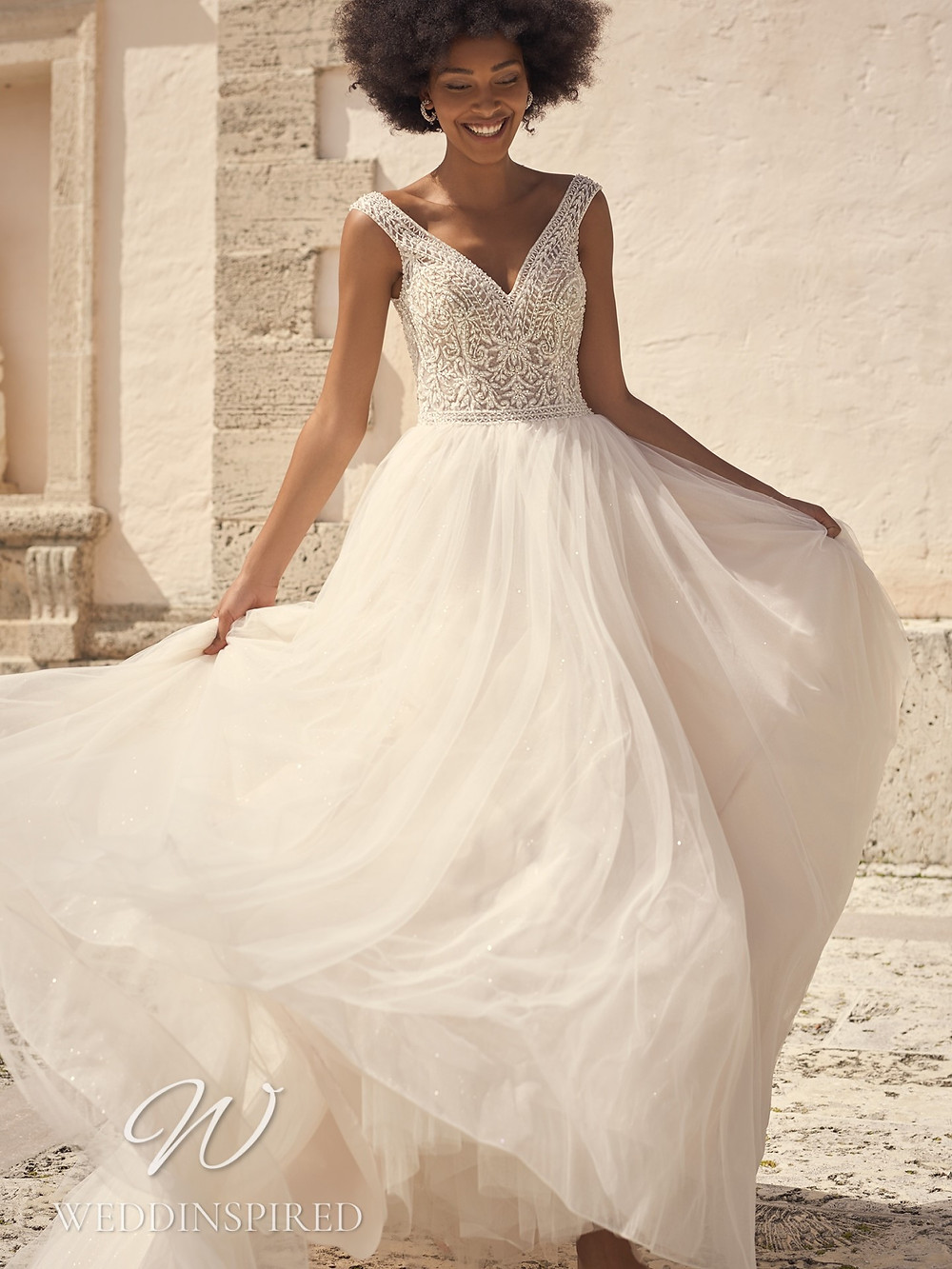 A Sottero & Midgley 2021 beading and tulle A-line wedding dress