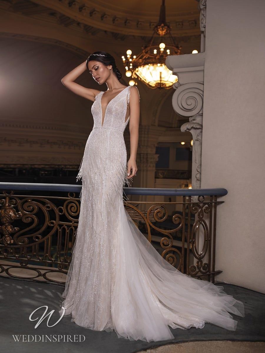 A Pronovias Privée 2021 sparkly fringe mermaid wedding dress with straps and a v neckline