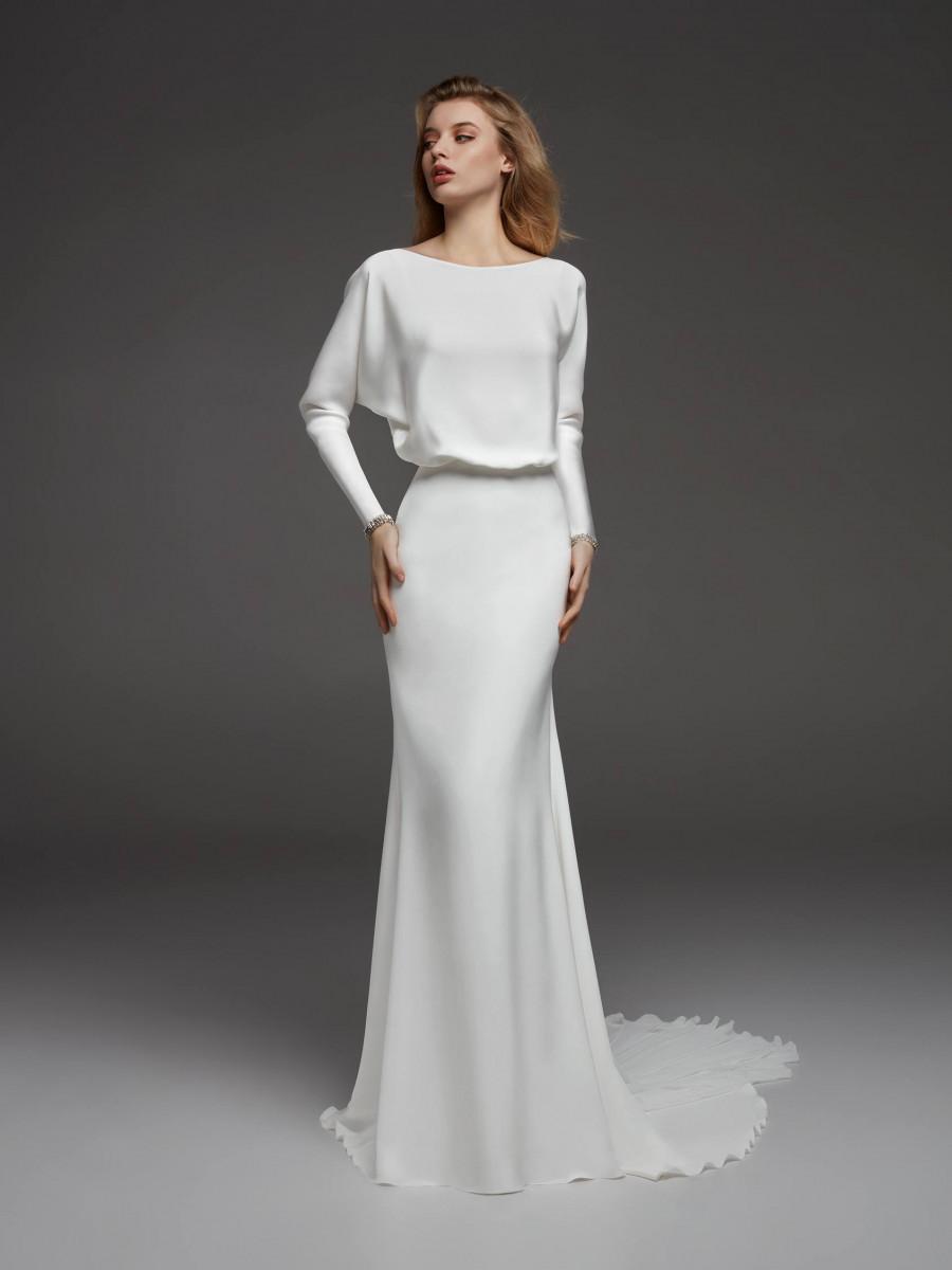 An Atelier Pronovias modest sheath wedding dress with long sleeves