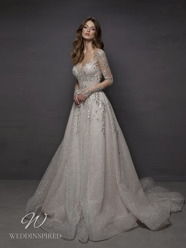 A Riki Dalal 2021 sparkly silver A-line wedding dress with long sleeves