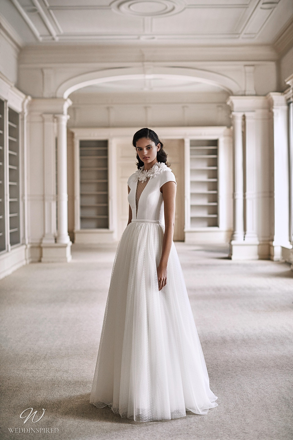 A Viktor & Rolf 2021 A-line wedding dress with polka dot tulle, cap sleeves and flowers