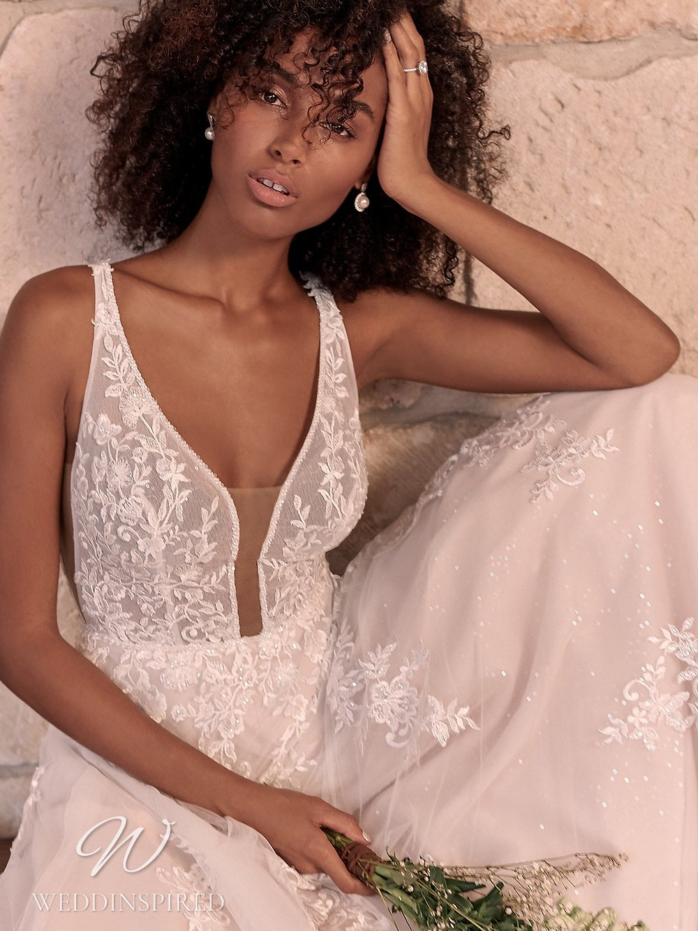 A Maggie Sottero Spring 2021 lace and tulle A-line wedding dress with straps and a v neck