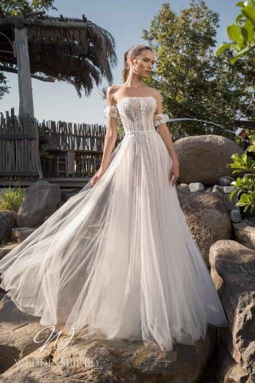 A David Hasbani lace and tulle strapless of the shoulder wedding dress