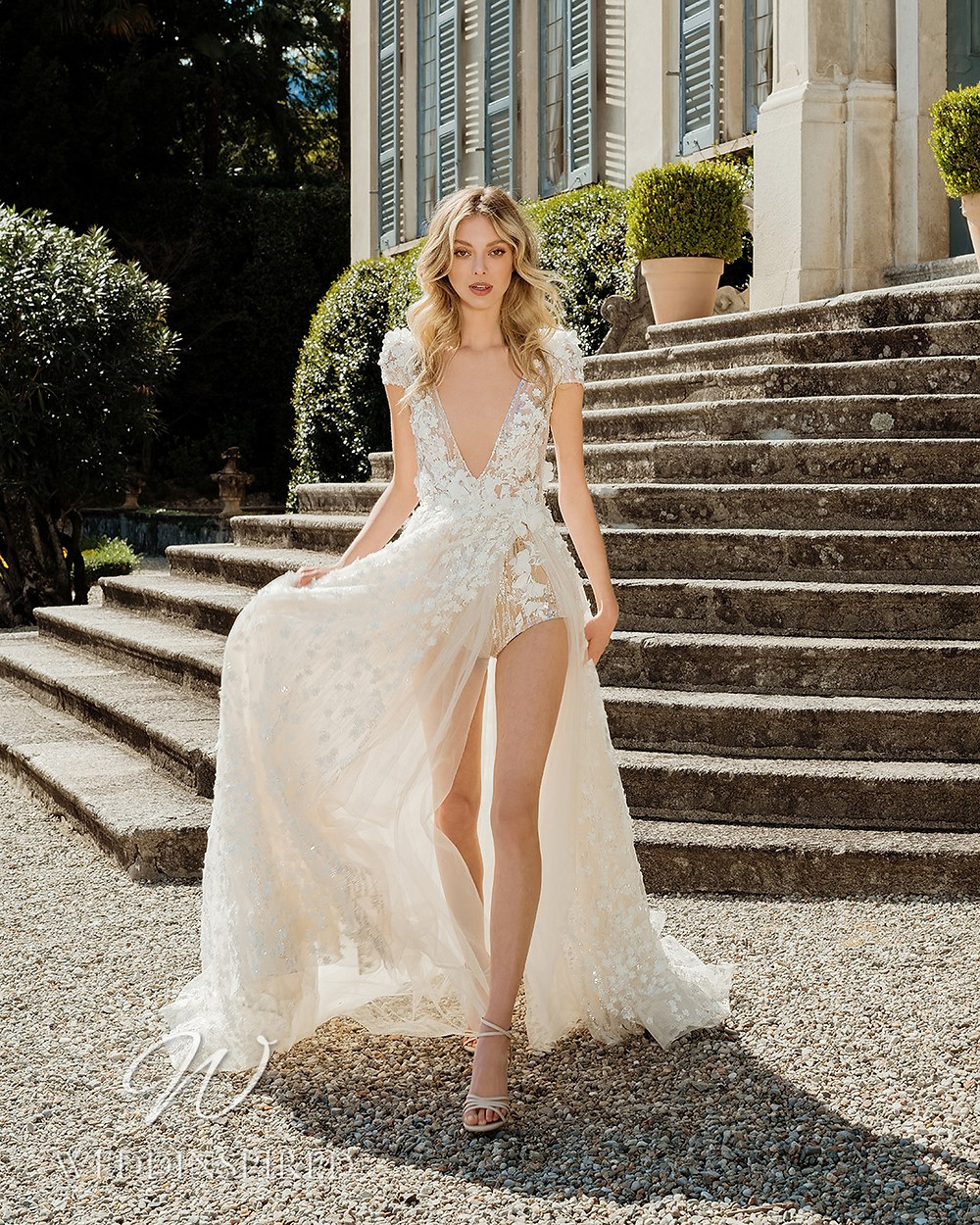 A Berta 2022 flowy tulle and lace boho A-line wedding dress with a v neck
