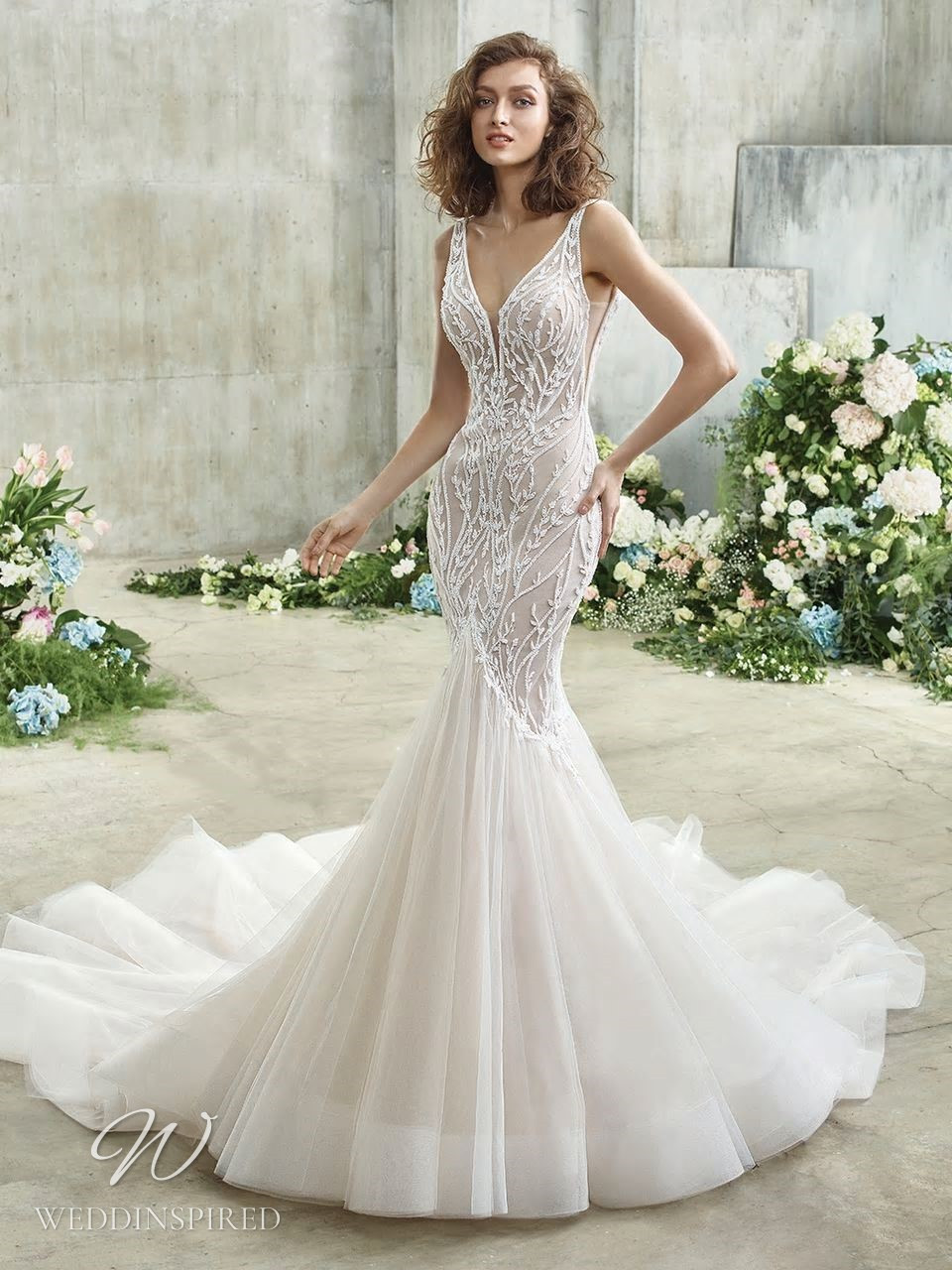 A Badgley Mischka gauzy mermaid wedding dress with a tulle skirt, beading and a v neckline