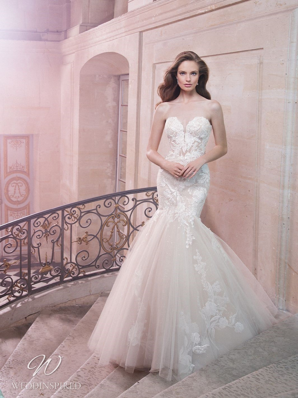 An Enzoani strapless lace and tulle mermaid wedding dress with a sweetheart neckline