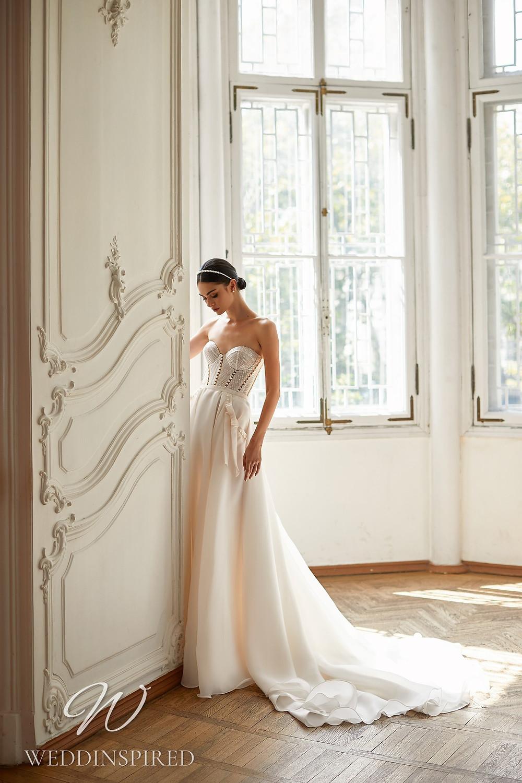 A Daria Karlozi 2021 strapless blush A-line wedding dress
