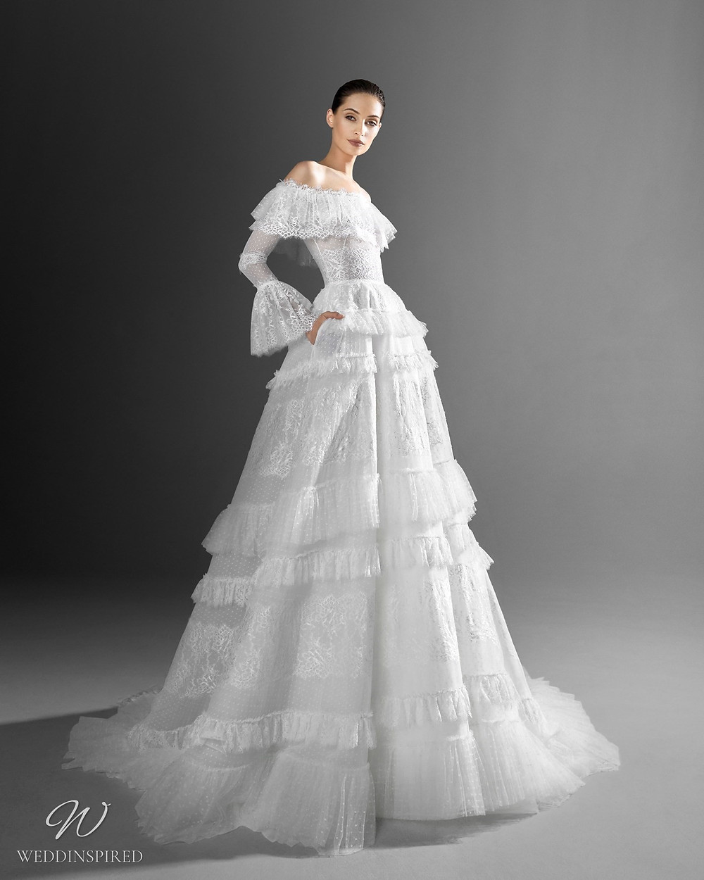 A Zuhair Murad off the shoulder ball gown wedding dress with ruffles and bell sleeves