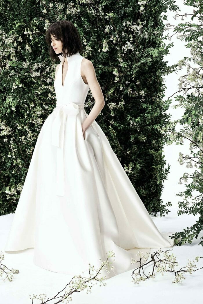 A Carolina Herrera simple silk ball gown wedding dress with pockets