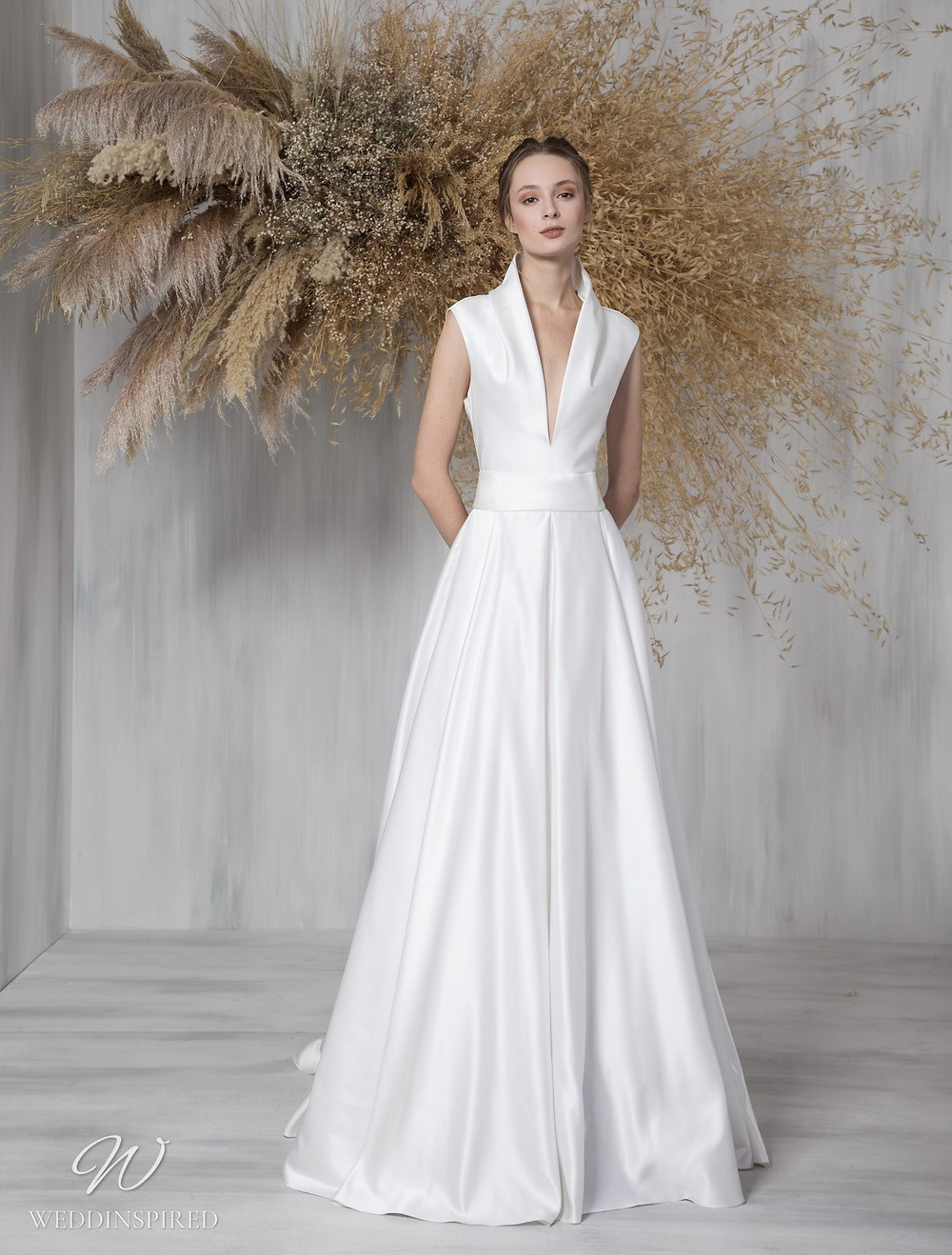 A Tony Ward 2021 satin A-line wedding dress with a v neck and a collar