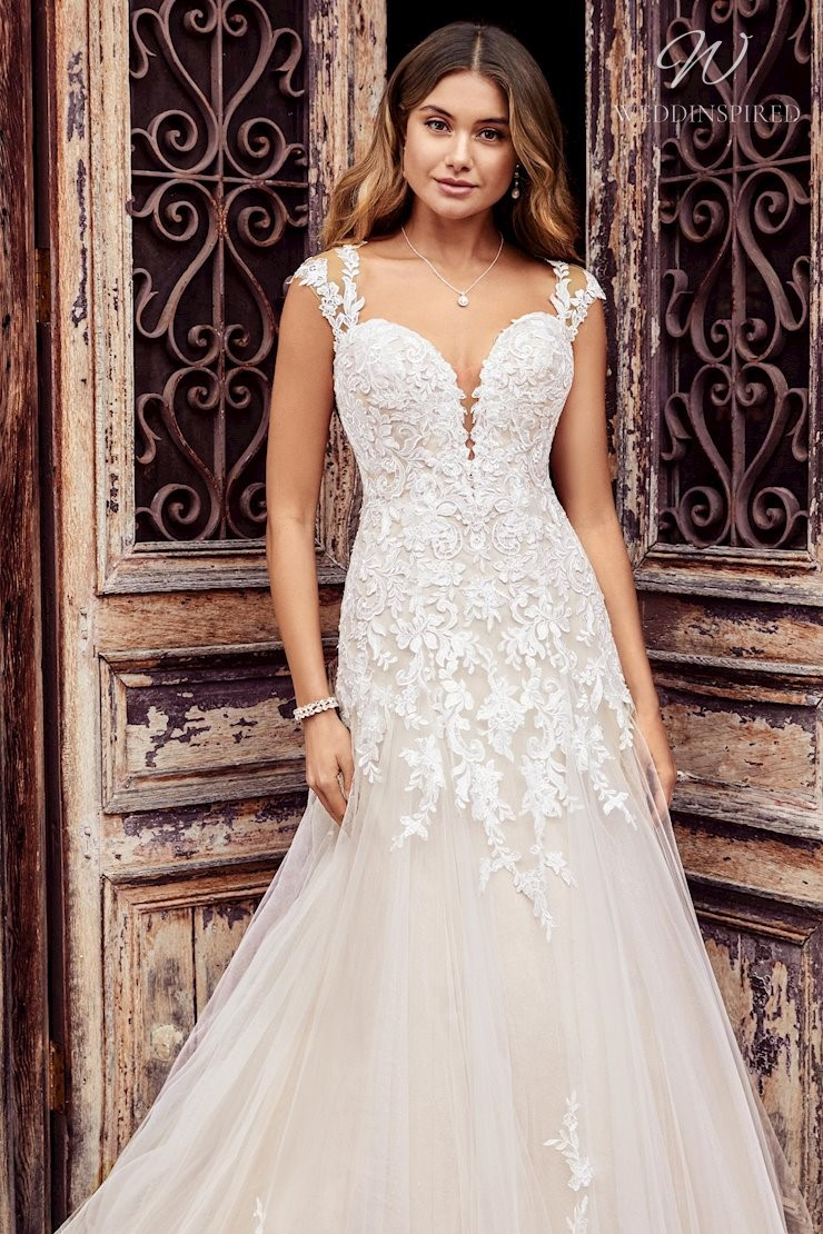 A Sophia Tolli blush lace and tulle A-line wedding dress