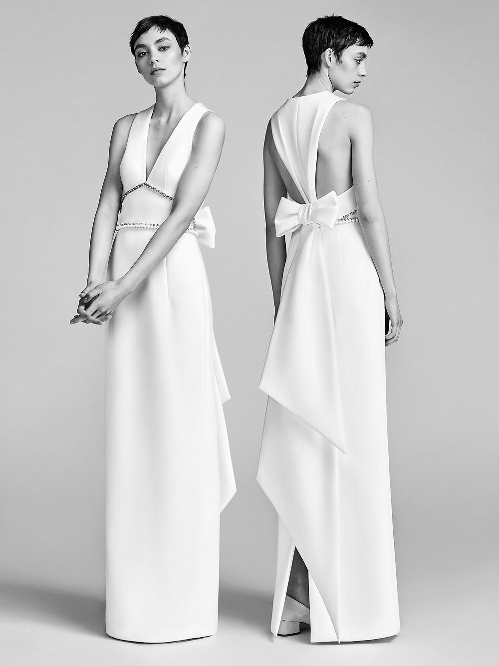 A Viktor & Rolf crepe column wedding dress with a v neckline and a bow