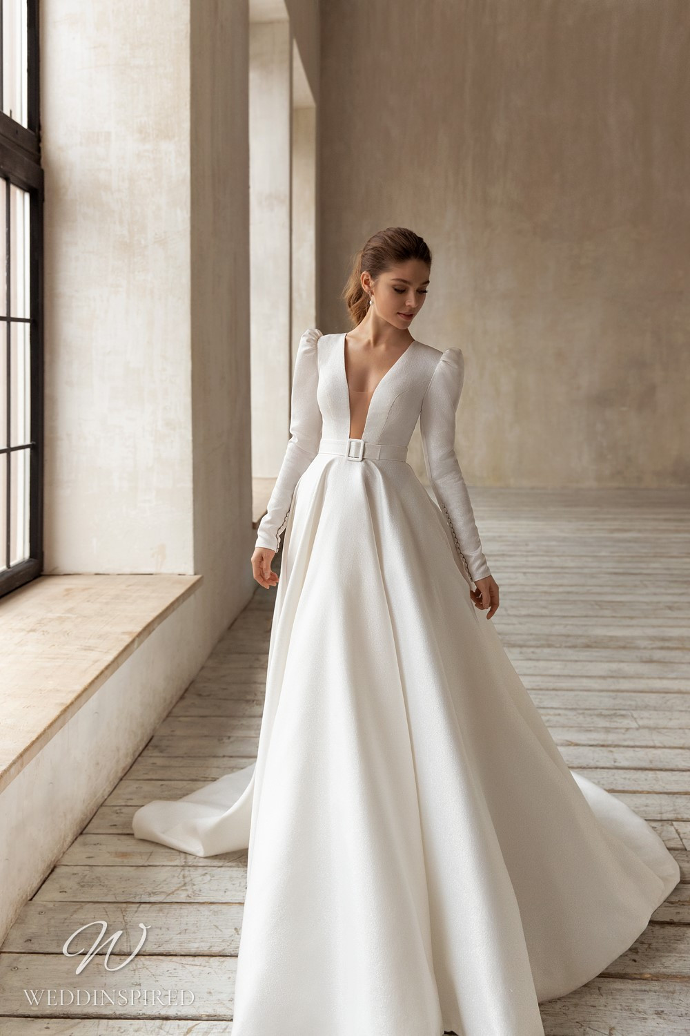 An Eva Lendel 2021 simple crepe ball gown wedding dress with long puff sleeves and a train