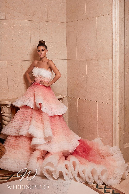 A Pollardi 2021 strapless blush tulle princess wedding dress with a ruffle skirt