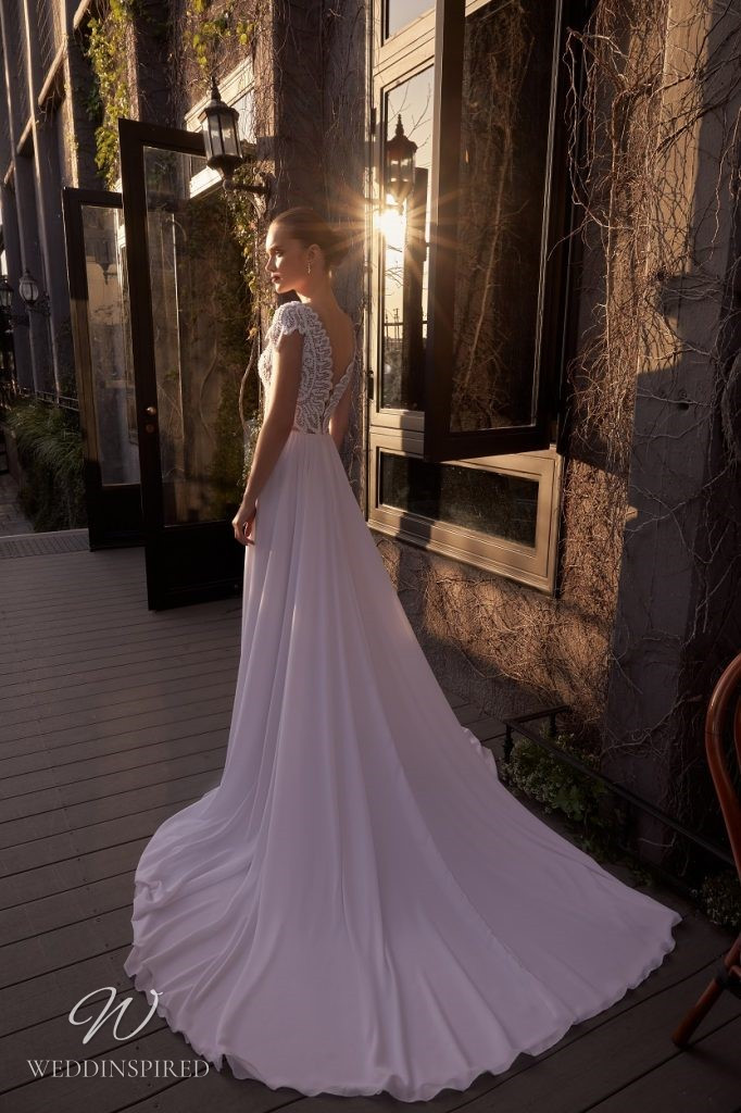 A Julie Vino 2021 crepe and lace A-line wedding dress with cap sleeves and a low back