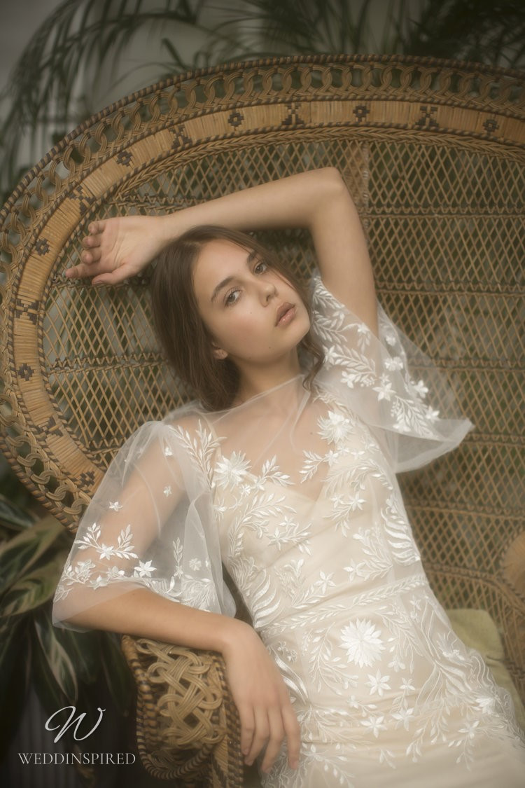 An Olwen Bourke sheath wedding dress with straps an illusion top and embroidery